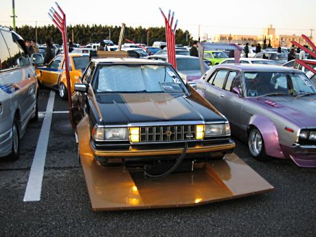 Toyota Crown S130 with spread winged exhaust