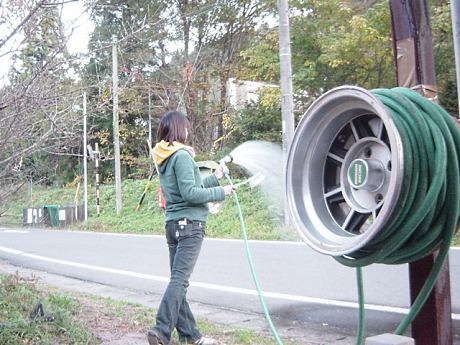 Hayashi Street rims used as garden hose reel