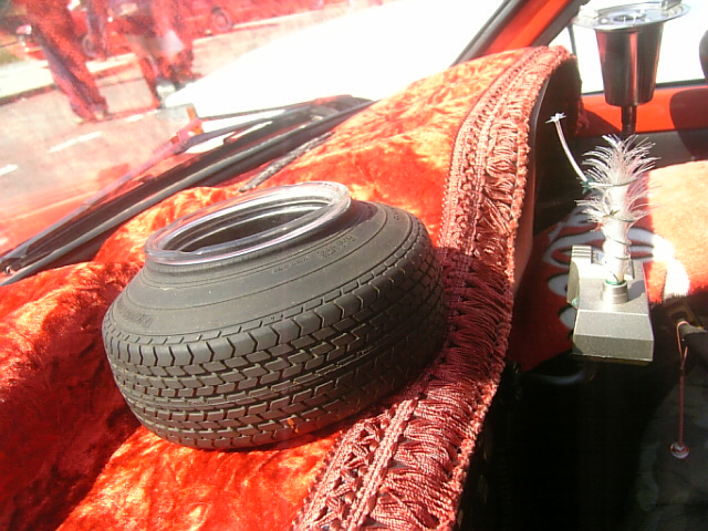 Stretched tire dashboard ornament